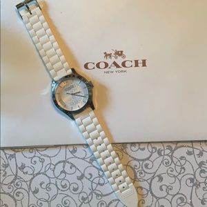 Coach watch with white silicone band.